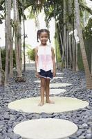 Girl Standing On Stepping Stone photo