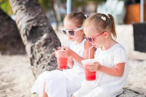 Portrait of little adorable girl on a tropical white beach photo
