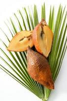 Salaks on palm-leaf photo