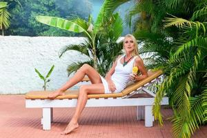 Young blonde woman at tropical resort