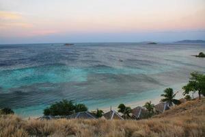 Sunset panorama on tropical Seraya Island, Indonesia photo