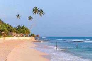 Tropical beach in Sri Lanka at sunset photo