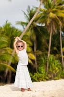 Adorable little girl on tropical beach vacation in Boracay, Phillipines photo