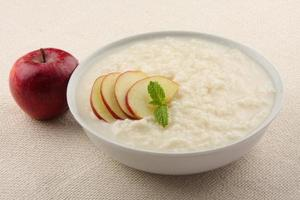 rice pudding with milk and apples photo