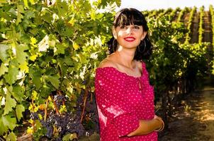 Playfull brunette in the vineyard