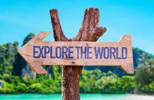 Explore the World arrow with beach background photo