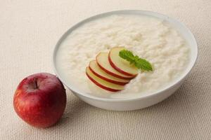 Homemade rice pudding with milk and apples. photo