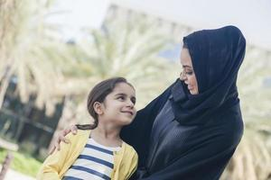 Arabic Mother And Daughter Outdoors photo