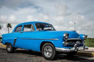 HDR blue american classic car with palms in Cuba photo