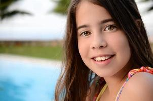Portrait of a teenage girl by the pool photo