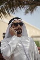 Arabian Male Using Smart Phone Outdoors
