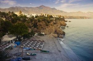 Nerja beach at sunset photo