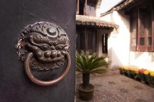 Patio of a traditional chinese house behind a closed door