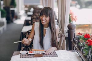 girl eat sushi photo