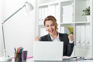 Beautiful happy business woman celebrating