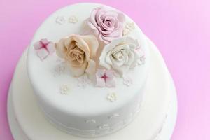 Sugar Flowers on top of wedding cake photo