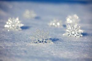 Snowflakes on snow photo
