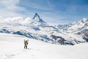 man celebrate success with the background of Matterhorn.