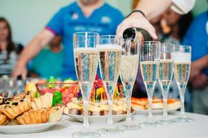 Pouring champagne into a glass on wedding celebration