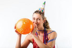 Woman celebrating birthday with balloon