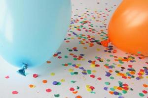 Blue and orange balloons with confetti