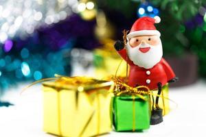 Santa claus christmas celebration with gift box photo