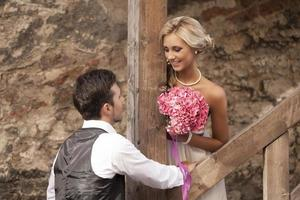 wedding, happy young man and woman celebrating photo