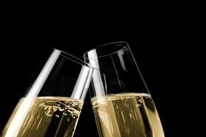 pair of champagne flutes with golden bubbles