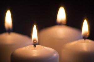 Candles light burning close-up plain background photo