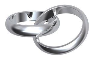 Dos anillos de bodas de plata aislado en blanco foto