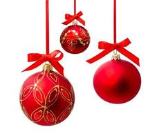 Hanging red christmas ball isolated photo