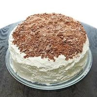 Layer cake with whipped cream and chocolate