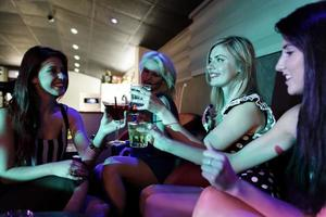 Group of friends having fun in a club