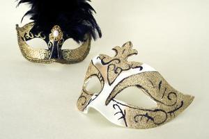 Two Venetian masks on yellow background photo