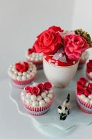 Close-up of party cupcakes and sugared roses