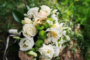 wedding bouquet at green grass