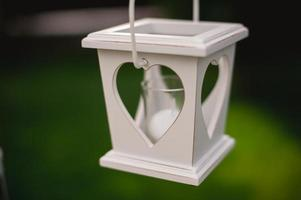 White candle holder with heart shaped hole