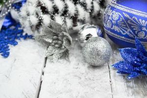 Christmas balls and snowflake on wood