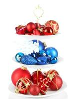 Christmas decorations on dessert stand, isolated on white photo