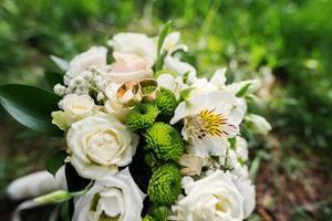 wedding bouquet at green grass photo