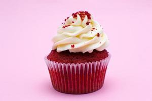 Cupcake on pink background photo