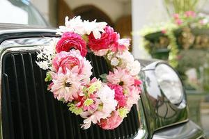 car with wreath