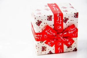 Gold gift box with  ribbon and bow isolated