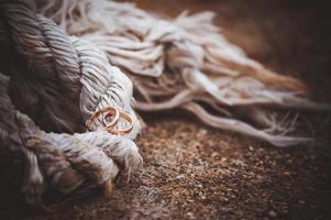 wedding rings laying on rope