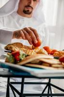 Arabian Male Having Breakfast