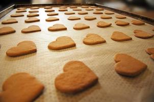 Baking tray with heart shaped cookies photo