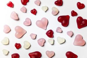 Pink and red gum hearts on white background photo