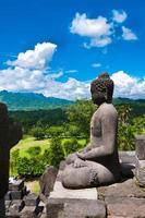 Buddha statue. Mountain on background. Borobudur. Java. Indonesi