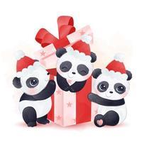 bebê pandas brincando com caixa de presente de natal