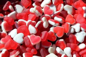 Red and white heart shaped gum candies - love concept photo